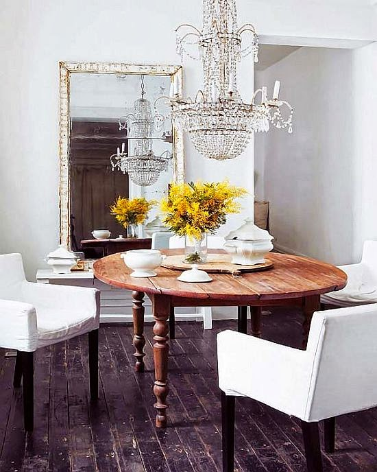 natural dining room with little yellow flowers and white chairs