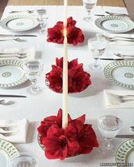 red amaryllis white candles Christmas table