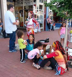 dancers, kids, pedestrians on the street