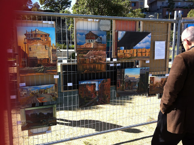 Exhibition of paintings of Pyrmont by Jane Bennett at the 2013 Pyrmont Festival in Pirrama Park