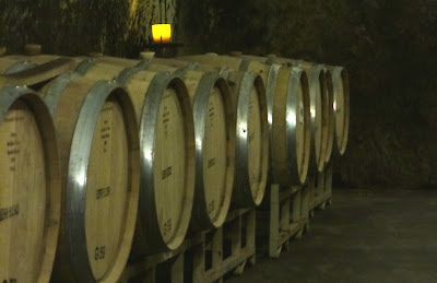 Aging barrels in the cellar at Beringer Vineyards