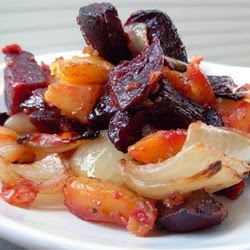 Beets baked with sweet potatoes and onion make for a colorful ...