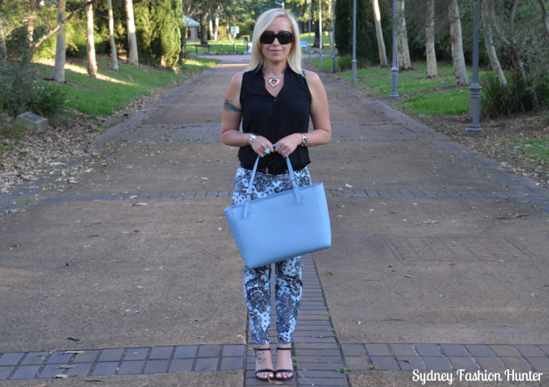 Blue Printed Pants, Black Sleeveless Shirt, Blue Tote, Black Sandals