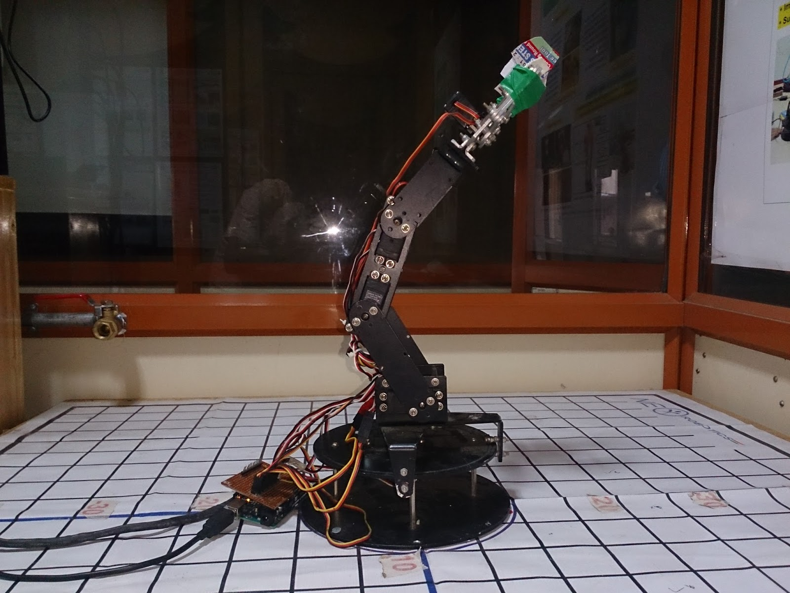 Mobile controlled 3 Axis Pick and Place Robot using DTMF
