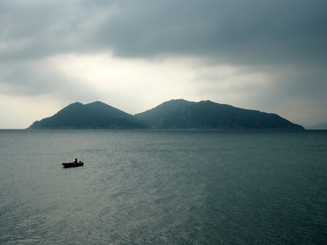 Shek Kwu Chau Island, and boat at sea, taken from near the Reclining Rock on Cheung Chau Island, Hong Kong