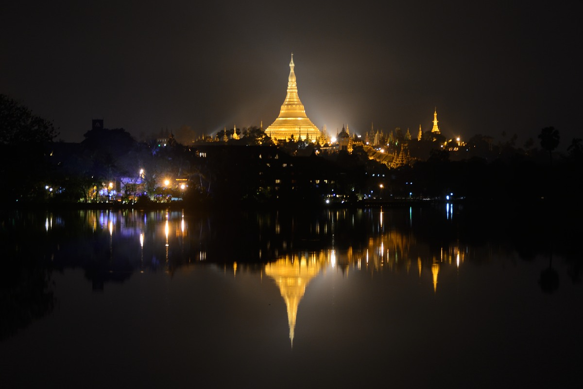 Shwedagon Pagoda in Yangon reflected in lake