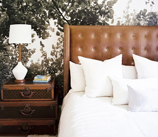 suitcases as side table, masculine bedroom, tailored bedding, warm interiors, art in the bedroom