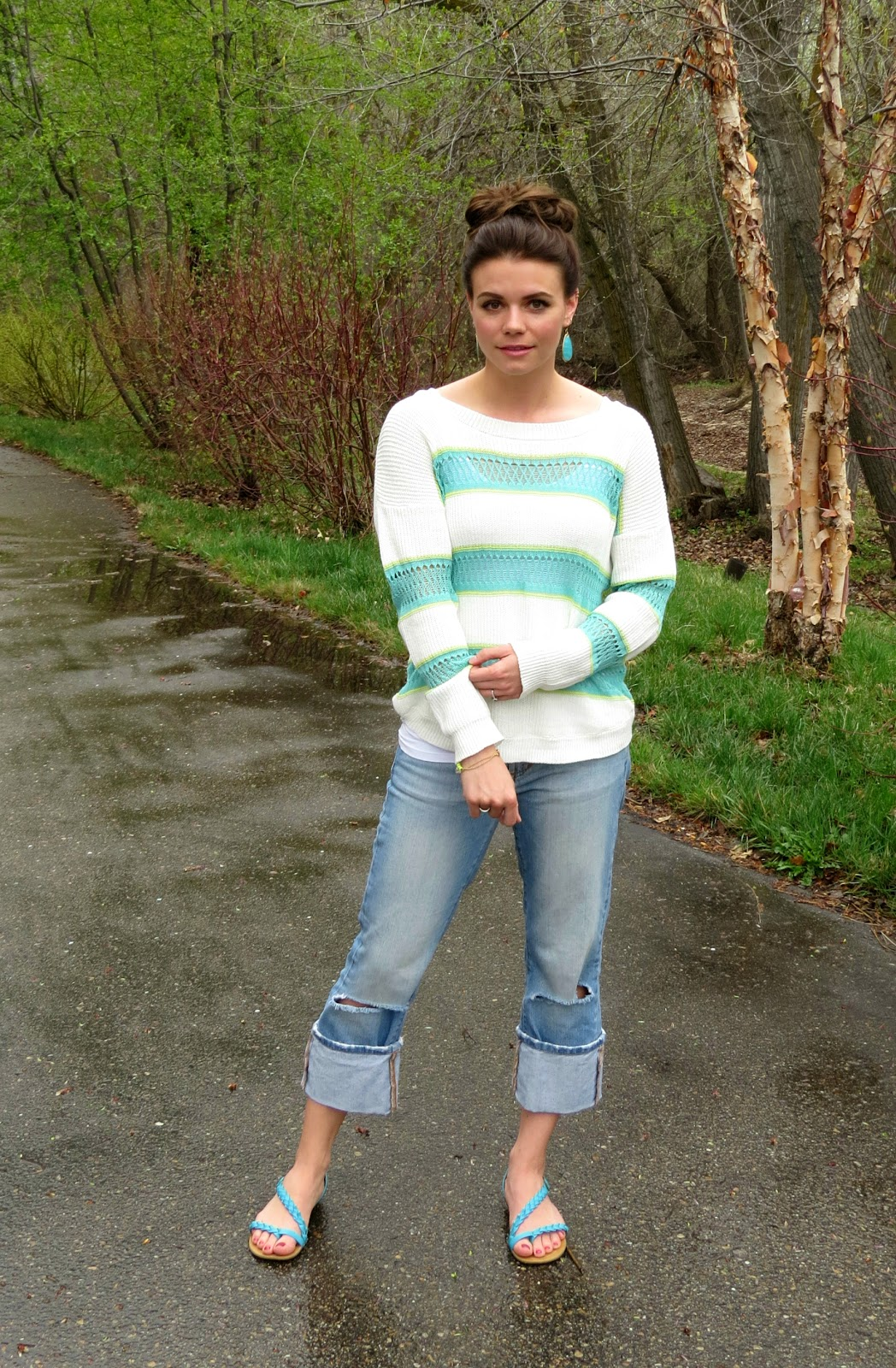 striped mint sweater and ripped jeans