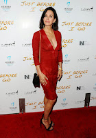 Courteney Cox glamorous in a red dress