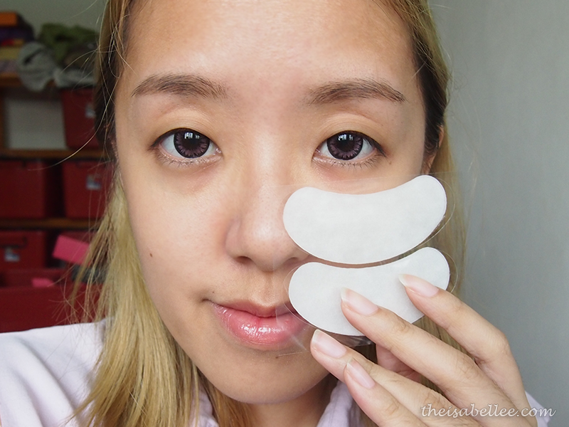 Applying Cettua Half Moon Brightening Eye Patch on eye