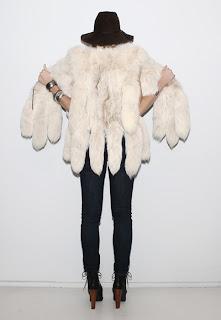 Vintage 1970's bohemian style white arctic fox tail fur vest.