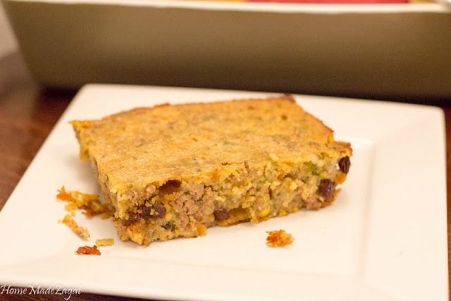 An alternative to the traditional pastelle from Trinidad and Tobago. A one pot baked pastelle pie with cornmeal, minced meat, raisins, capers and olives.