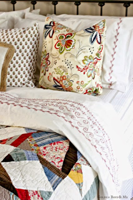 Mixed pattern bedding with Pottery Barn multistar quilt and Ikea duvet cover-www.goldenboyandme.com