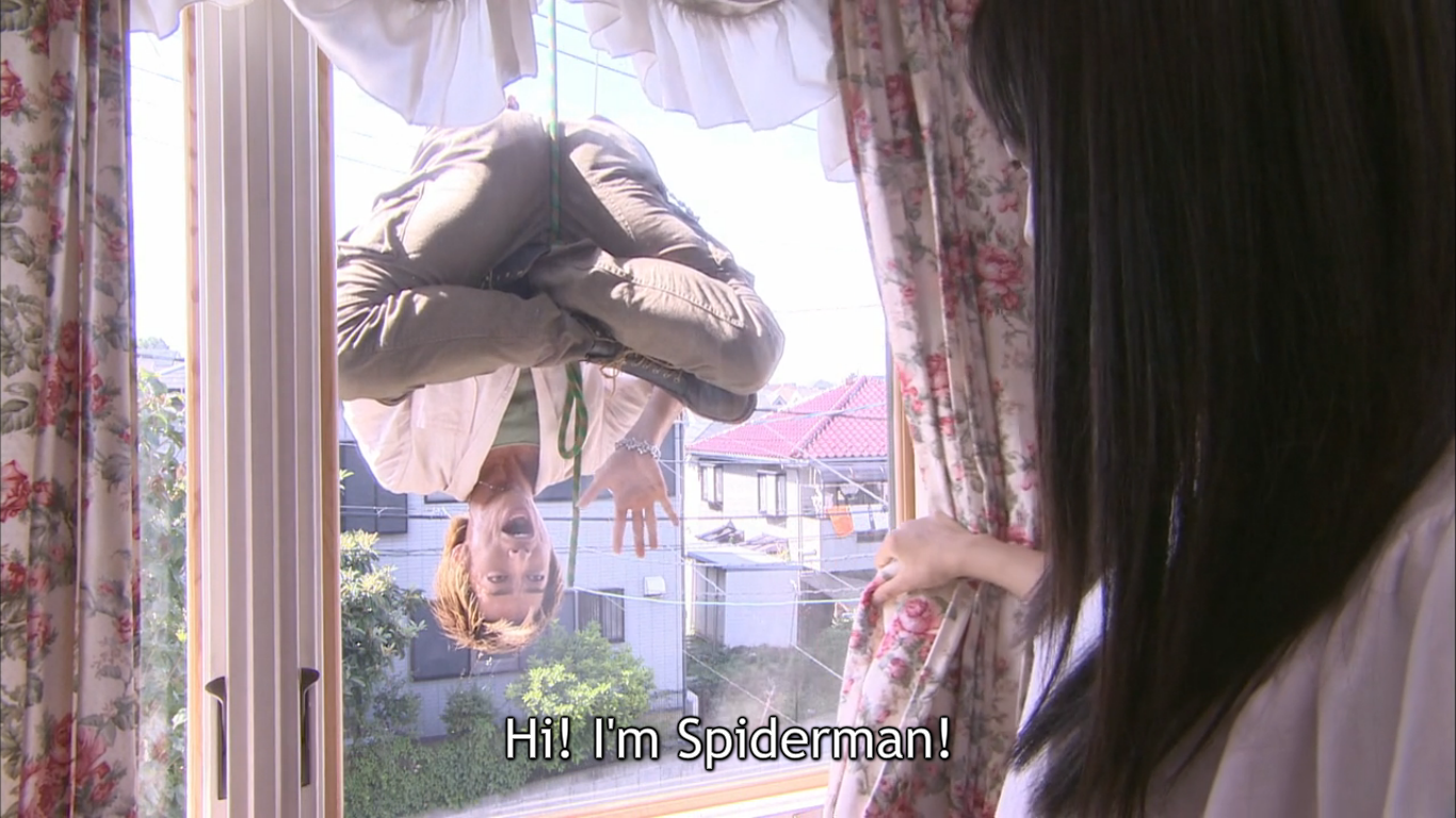 Onizuka hanging upside down outside a female student's window, claiming to be Spiderman.