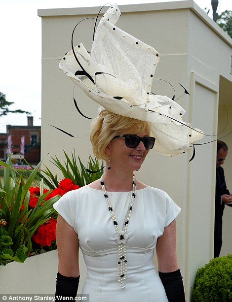 pretty lady in cream and black outfit on Ladies' Day of Royal Ascot 2014