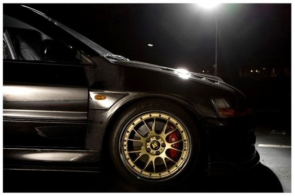 Black Carbon Mitsubishi Evo with Gold Rims and Brembo Brakes