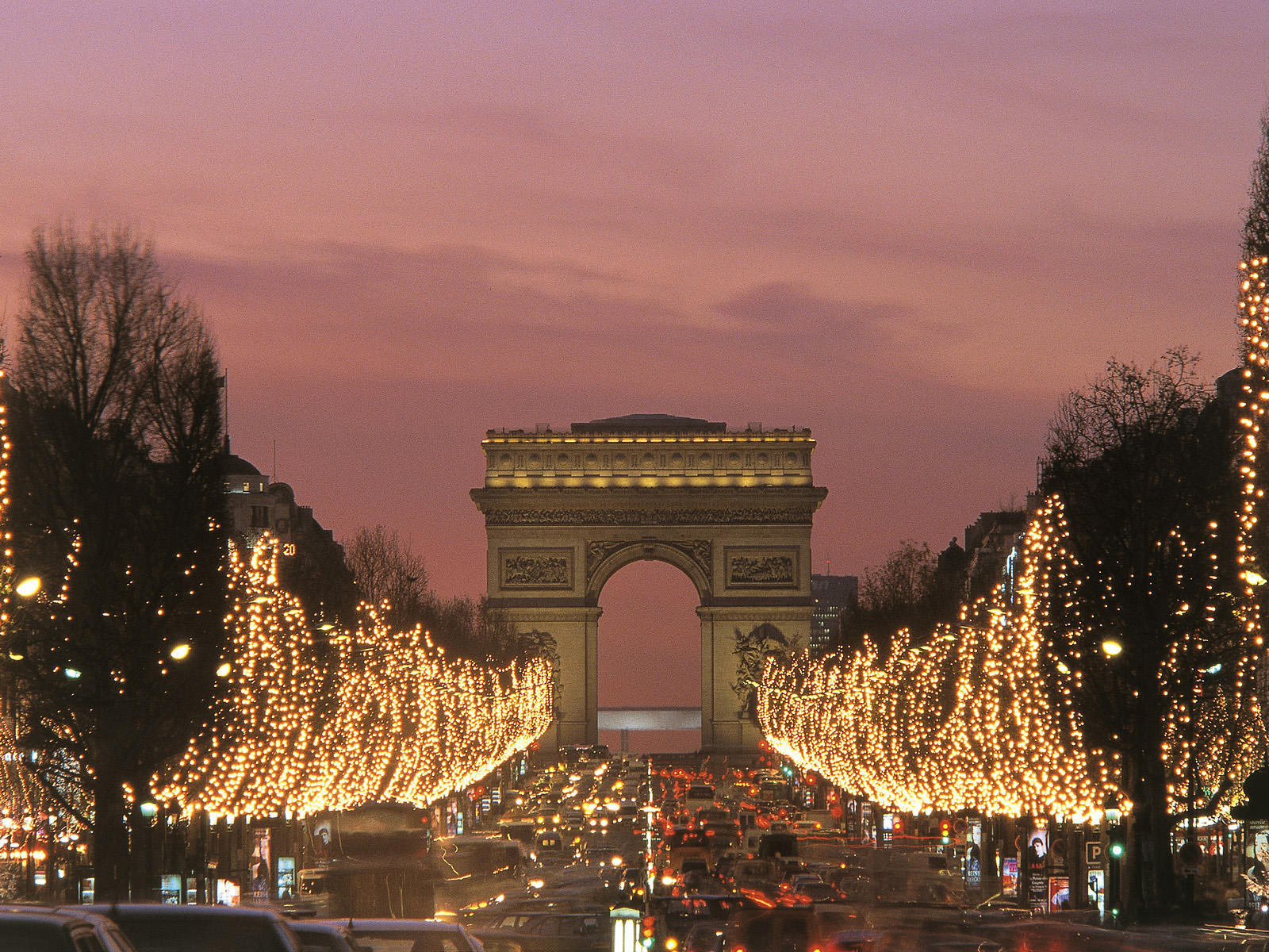 Discovering The City of Lights by Christmas Discovering The City of Lights by Christmas Champs Elysees in December Arc de Triomphe Paris France