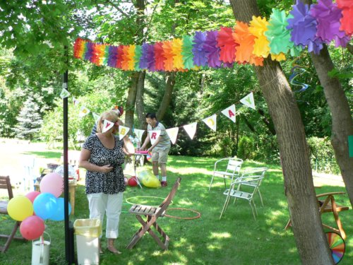 setting up rainbow birthday party decorations