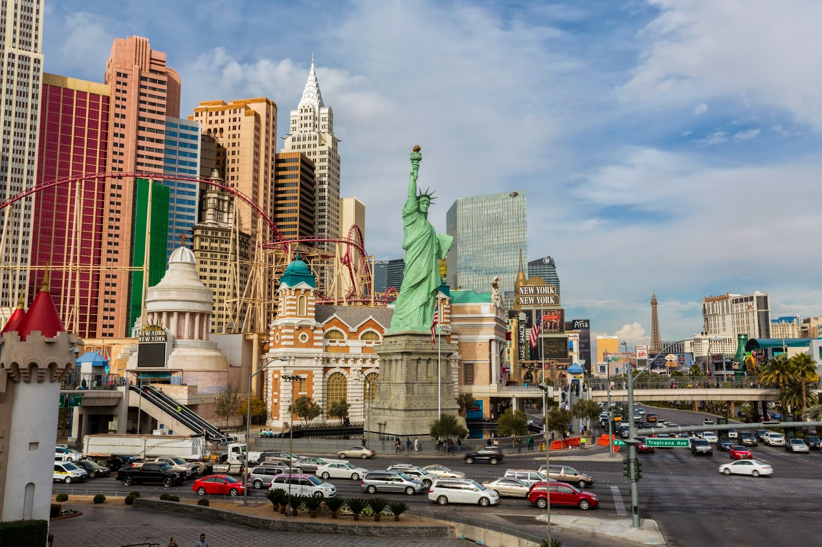 here is a photo of new york new york shot on a pedestrian overpass in the center is las vegass famous mini statue of liberty