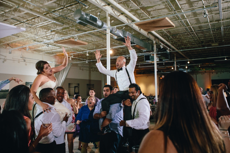 bride and groom dancing at their reception at american spirit works