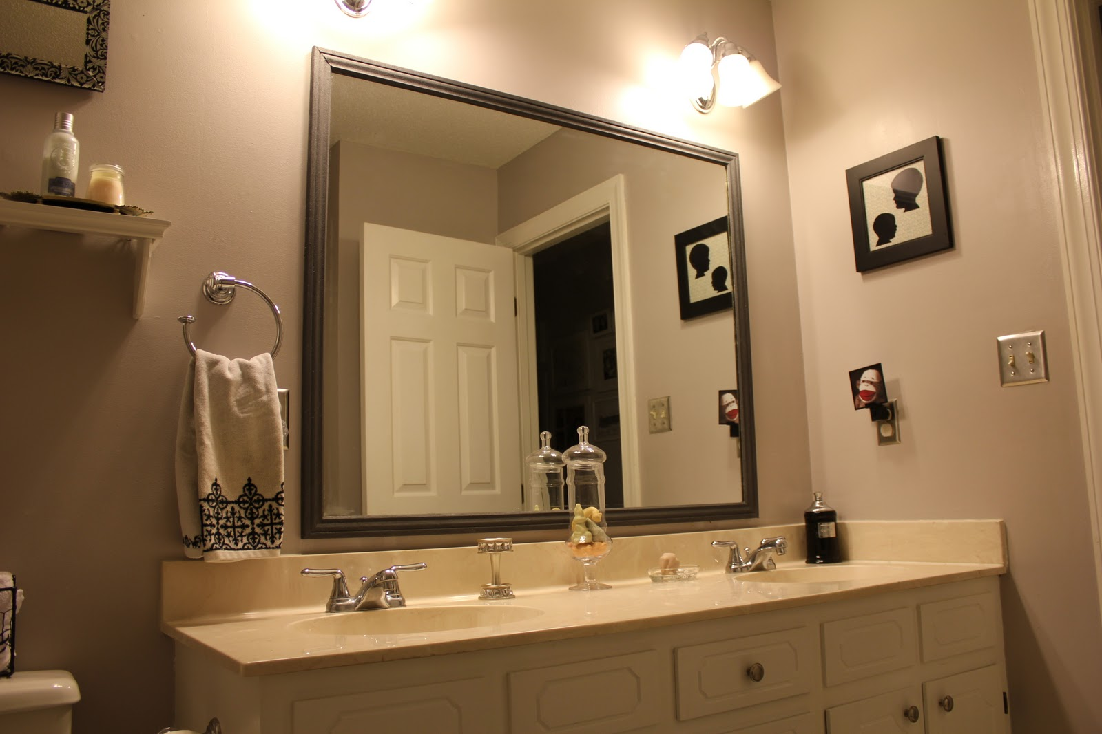 Peahen pad framing an existing bathroom mirror for Bathroom wall mirrors