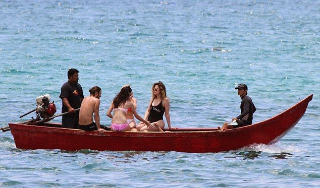 Kendall Jenner strips down in a Pink Bikini on paddle boarding session in Thailand