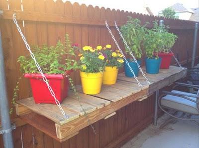 Reutilizar palets de madera para apoyar las plantas