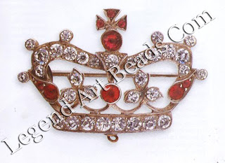 A silver brooch in the form of a royal crown, set with white and red crystals simulating diamonds and rubies. There is a ring located at the bottom of the brooch to which there would originally have been attached a safety chain and catch. Late 1910`s. £I00-50 ($170-233)