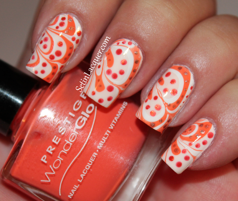 Water marble with dotted accents with Prestige Cosmetics nail lacquer