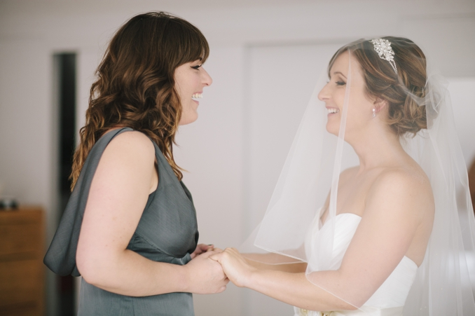 Gorgeous bride sharing a moment with her sister photo by STUDIO 1208