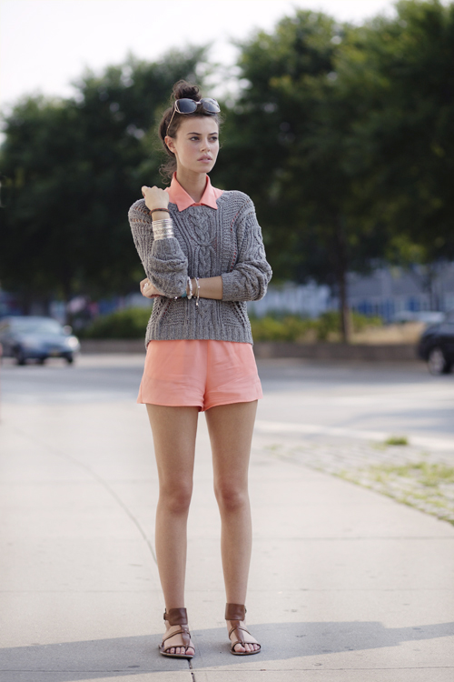 Via The Sartorialist-peach romper with grey sweater