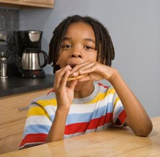 African American Kid Eating