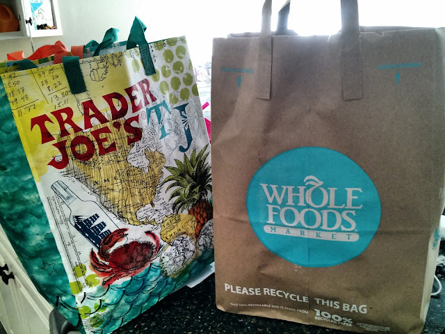 comparing whole foods and trader joe's