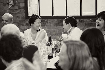 bride and groom looking at each other during speeches at St Chads place wedding