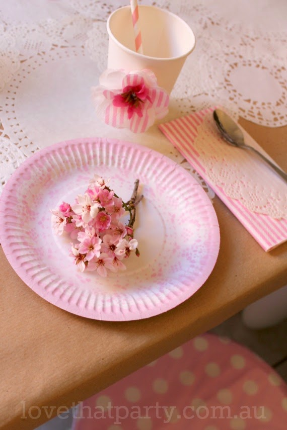 image of pink and white paper doily birthday party table