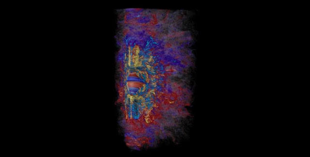 Supercomputer visualization of the toroidal magnetic field in a collapsed, massive star, showing how in a span of 10 milliseconds the rapid differential rotation revs up the stars magnetic field to a million billion times that of our sun (yellow is positive, light blue is negative). Red and blue represent weaker positive and negative magnetic fields, respectively. Credit: Robert R. Sisneros (NCSA) and Philipp Mösta.