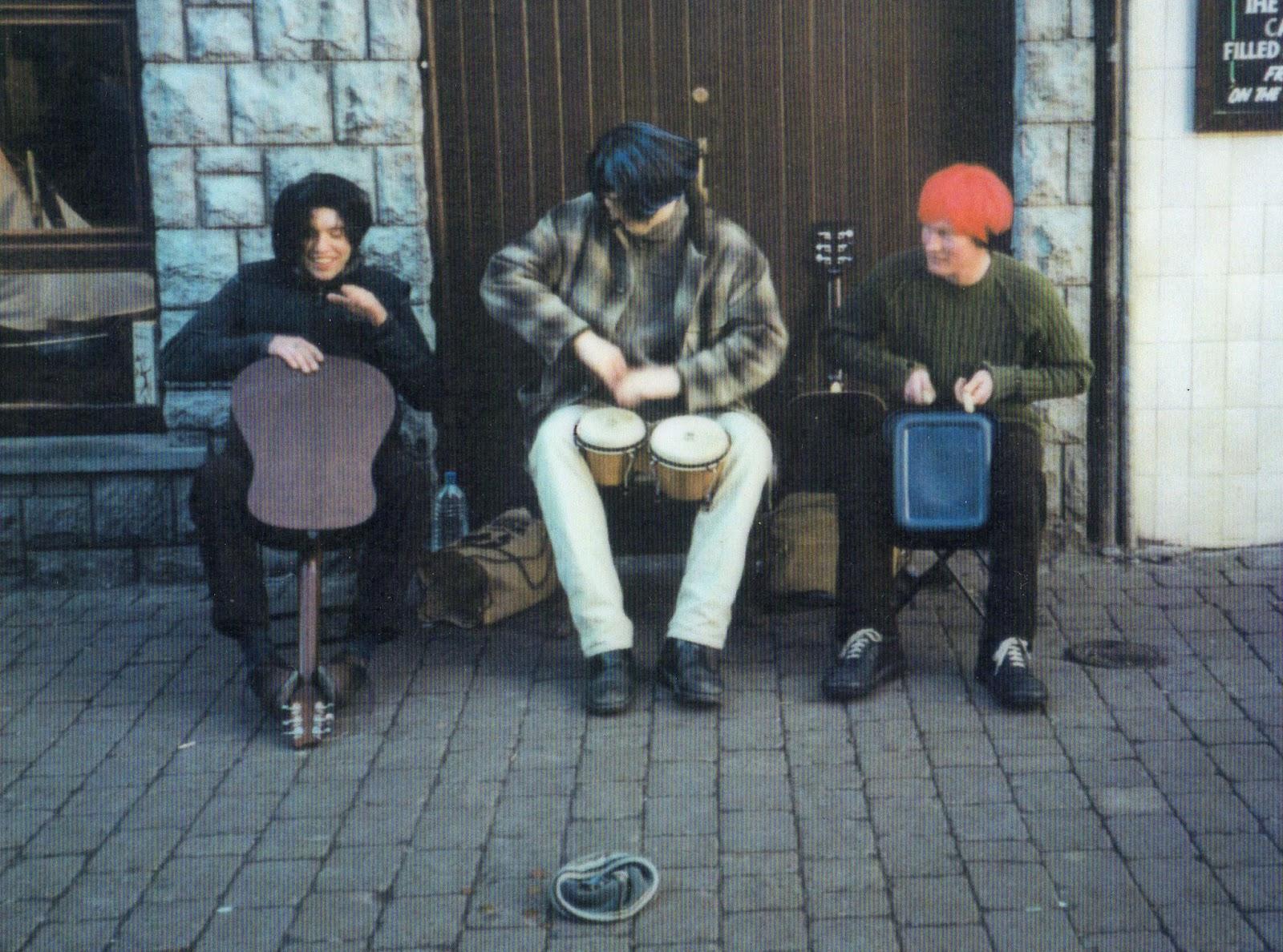 Three men in wigs busking in Galway, Ireland
