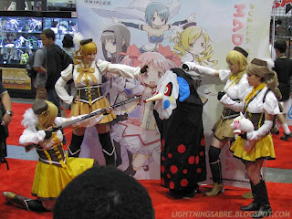 Various Cosplayers Cosplay as Mami and Charlotte from Puella Magi Madoka Magica
