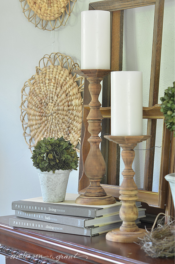 my mantel decorating started with the rustic candlesticks i made and