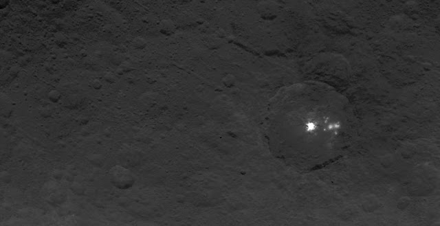 A cluster of mysterious bright spots on dwarf planet Ceres can be seen in this image, taken by NASA's Dawn spacecraft on June 9, 2015. Credits: NASA/JPL-Caltech/UCLA/MPS/DLR/IDA