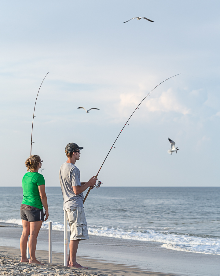 Seldom seen couple fishing for Rehoboth beach fishing
