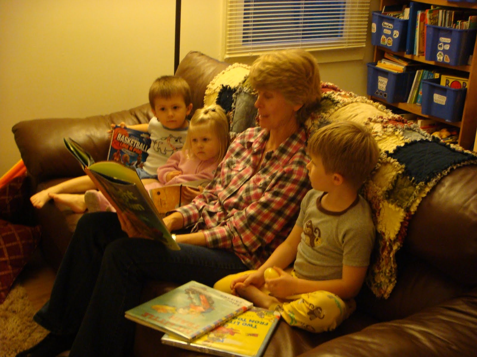 This is Gramma's last picture reading to her grandkids on the couch in IL :)