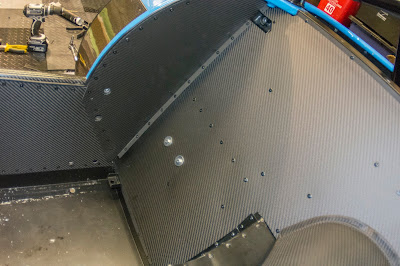 The rear bulkhead, and drivers side fitted with the new Caterham Carbon Interior panels