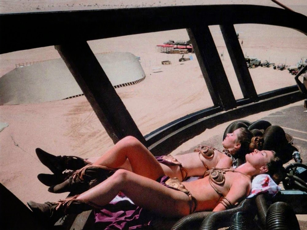 carrie fisher behind the scenes, empire strikes back, star wars, jaba the hut outfit, bikini, sun-bathing with stunt double on set in the desert