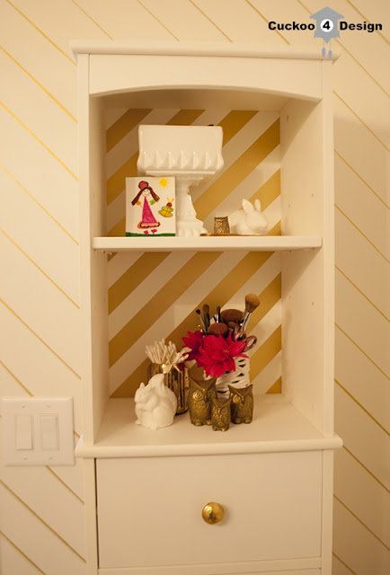 gold and white striped medicine cabinet