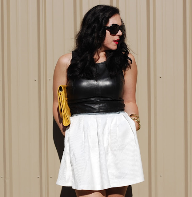 Leather peplum top and white tulip skirt with a yellow Marc by Marc Jacobs clutch.