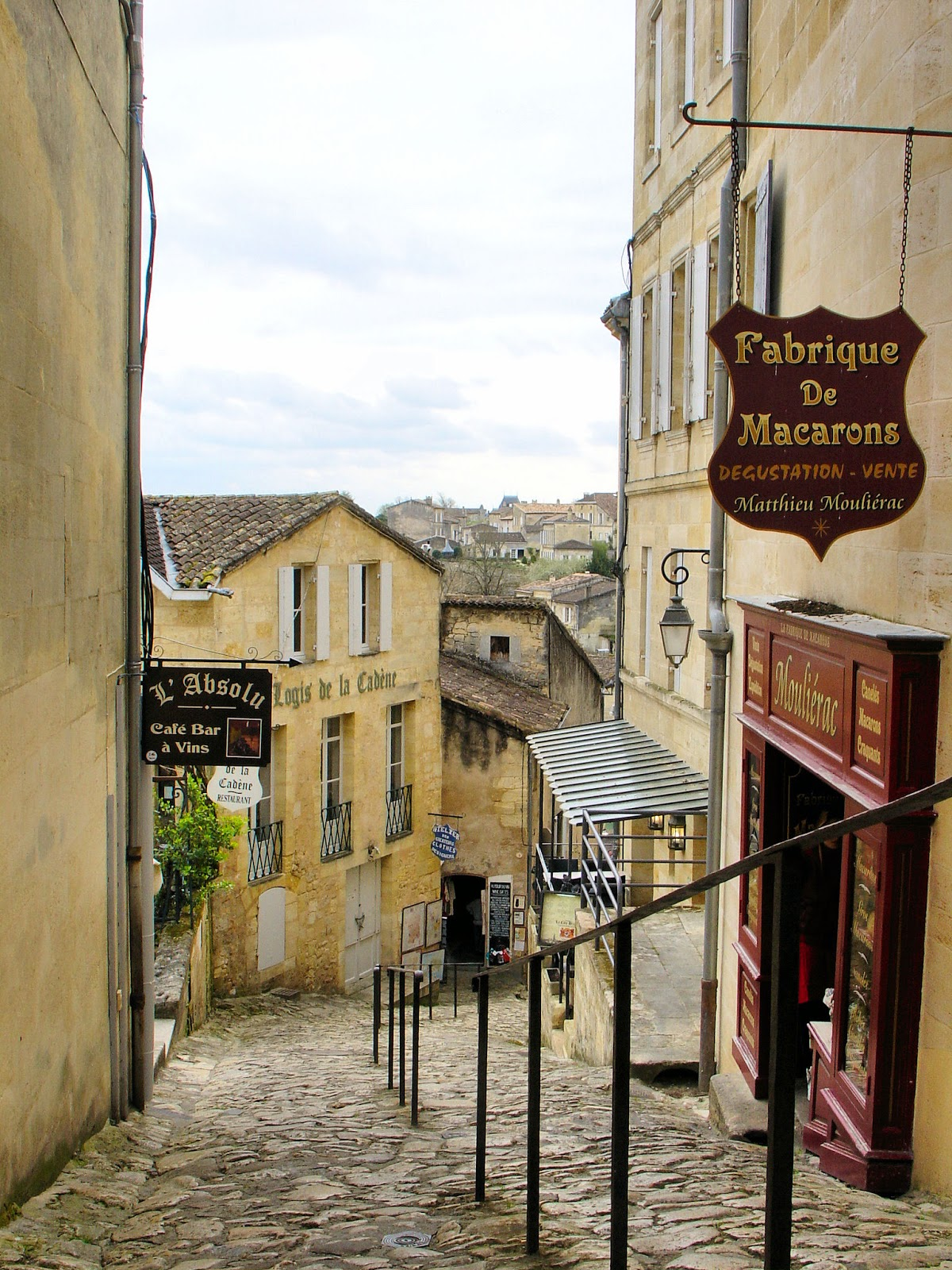 Cobblestoned lane leading down to the Monolithic Church and Church of the Holy Trinity in Saint-Emilion.