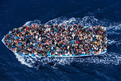 Refugees in boat heading for Europe Italy
