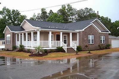 Modular home builder si from duck dynasty chooses clayton for Modular homes with wrap around porch