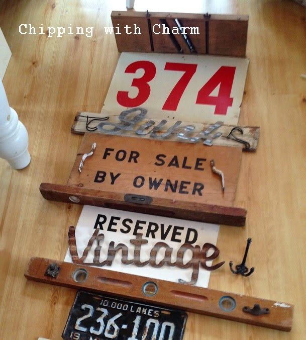 Chipping with Charm:  Crazy Signs and Hooks Wall...http://www.chippingwithcharm.blogspot.com/